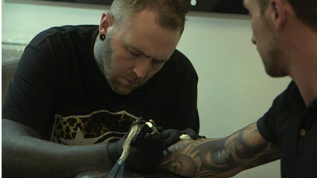 Tattoo artist Kevin Paul at work