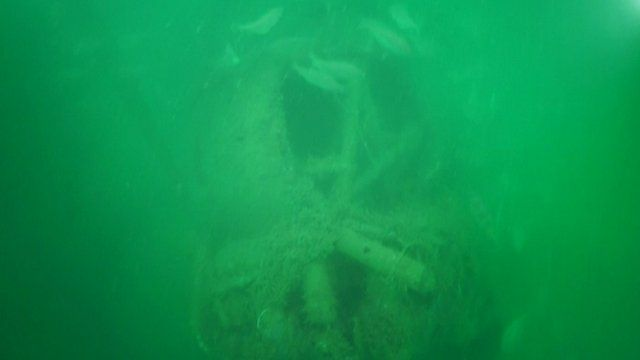 Footage shows the bomber beneath the waves