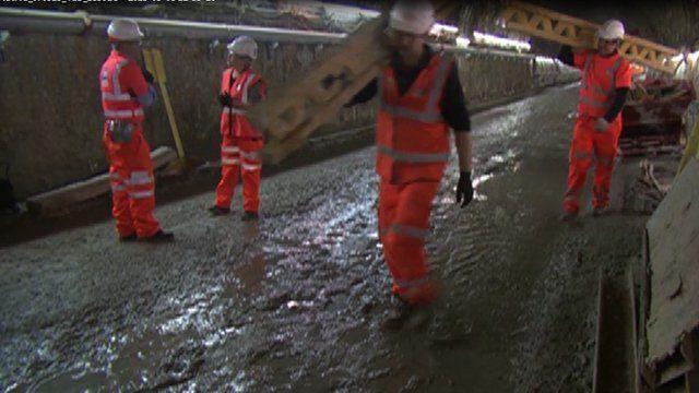 Workmen in tunnel