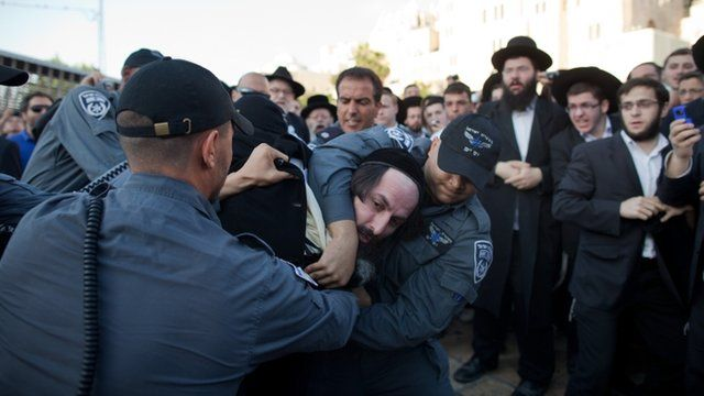"Israeli police officers arrest an ultra-Orthodox protestor objecting to the religious group ""Women Of The Wall"""