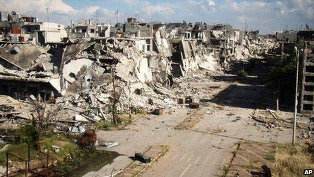 Photograph posted online by Lens Young Homsi purportedly showing war-damaged buildings in Homs, Syria (13 May 2013)