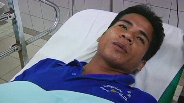 Factory worker in hospital following Cambodia shoe factory collapse