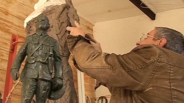 Artist John Doubleday at work on the statue