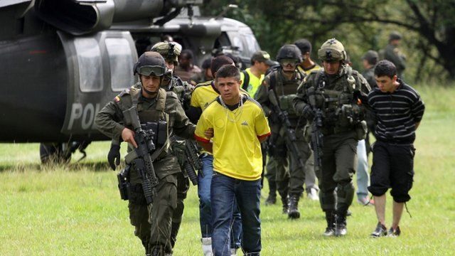Alleged rebels from Revolutionary Armed Forces of Colombia, or FARC, are escorted by Colombian Police agents in Cali, Colombia,