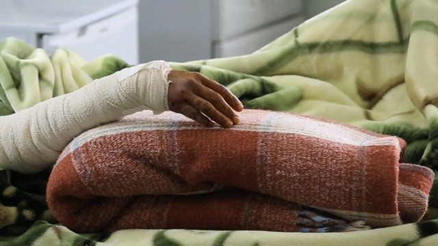 Mariam's hand resting on a blanket