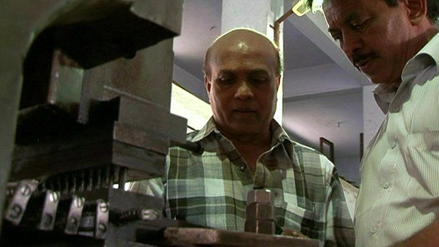 Ajay Modi, left, in his car components factory