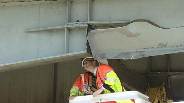 Engineers examine the damage to the A12 bridge near Kelvedon