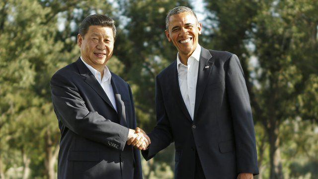 President Xi and President Obama shake hands