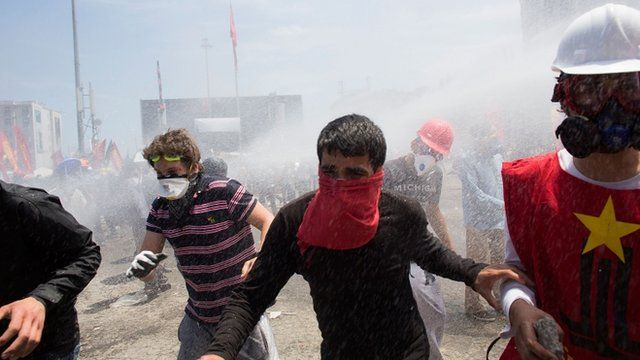 Riot police use water cannons and tear gas to disperse the crowd during a demonstration near Taksim Square