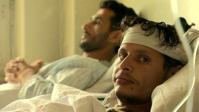 Men in hospital beds