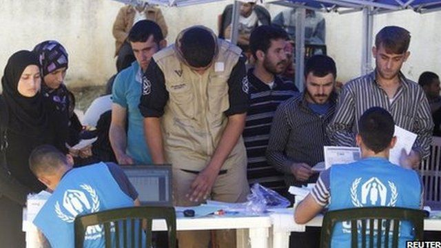 Syrian and Palestinian refugees register their names in order to receive humanitarian aid in Beirut