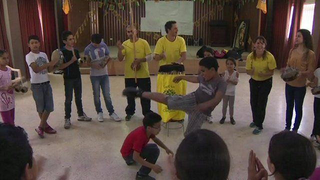 Palestinian boys and girls learning capoeira