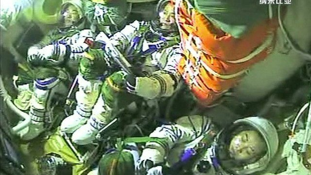 Astronauts in the capsule returning to Earth