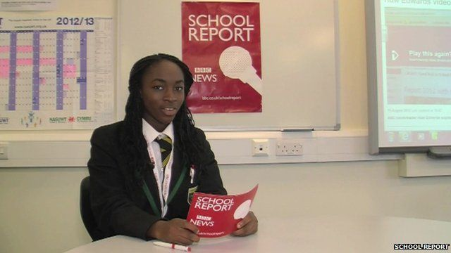 A School Reporter reading from a cue card for their news broadcast