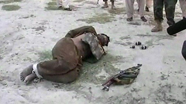 Alleged would-be suicide bomber lying on the ground with hands tied