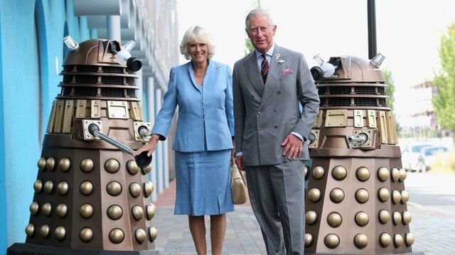 Prince Charles, Prince of Wales and Camilla, Duchess of Cornwall pose next to two Daleks as they visit BBC Roath Lock Studios on July 3, 2013 in Cardiff, Wales