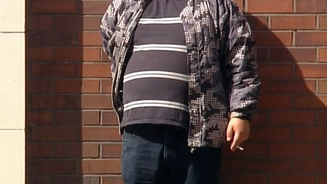 Overweight man with cigarette