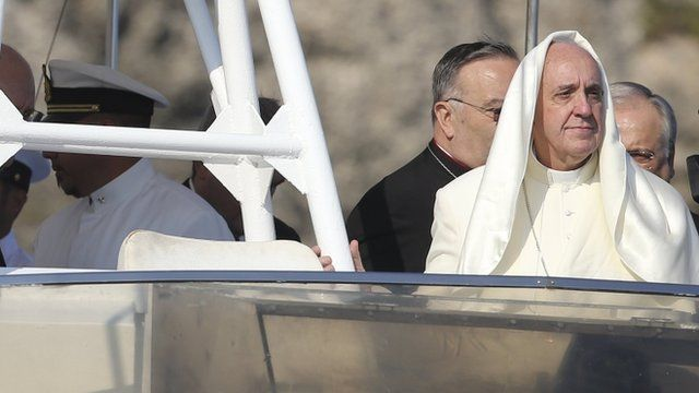 "A gust of wind lifts up Pope Francis"" mantle as he stands onboard a boat at Lampedusa Island, southern Italy, July 8, 2013"