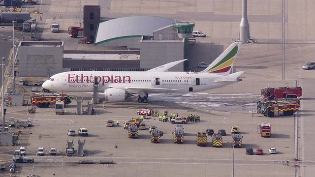 the Ethiopian Airlines Boeing 787 Dreamliner jet and emergency vehicles