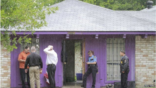Officials stand outside house in Houston