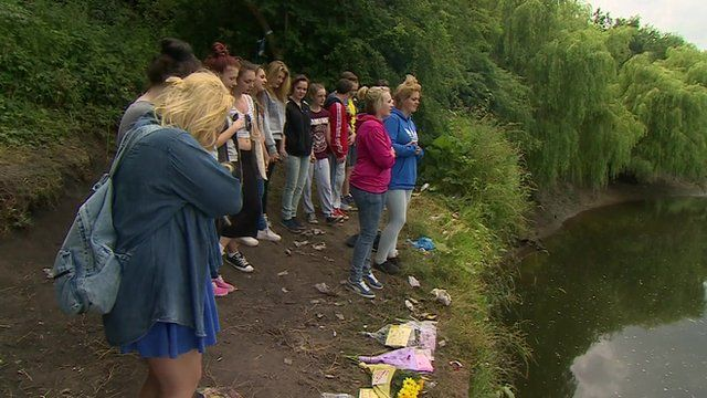 Friends of the girls at the river site where they died
