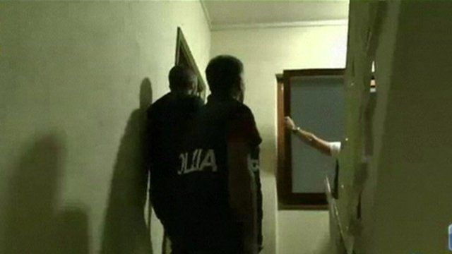 Police taking part in the dawn raids