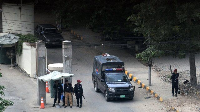 Security guards and police officers outside the US consulate in Lahore