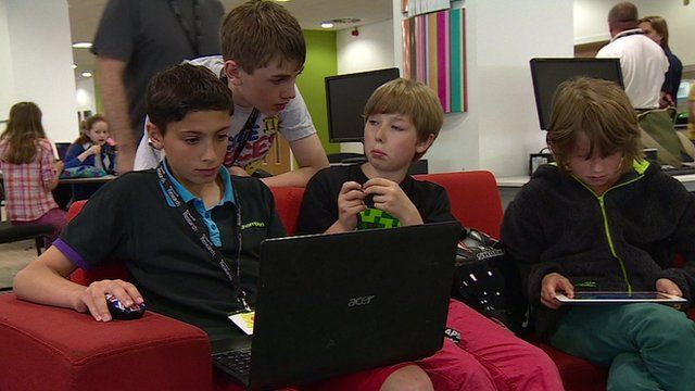 Children working on computers and tablets