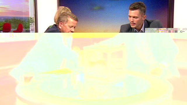 Bill Turnbull puts his hand into a box of mosquitoes