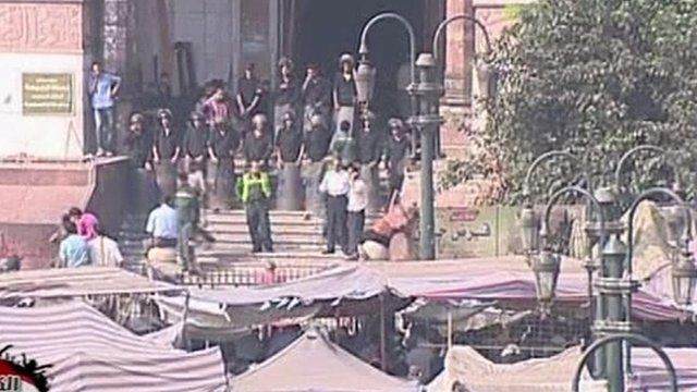 Security forces in riot gear outside the mosque