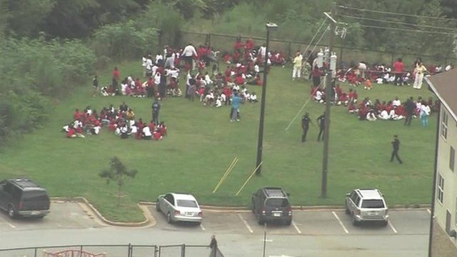 Aerial footage of students in a field
