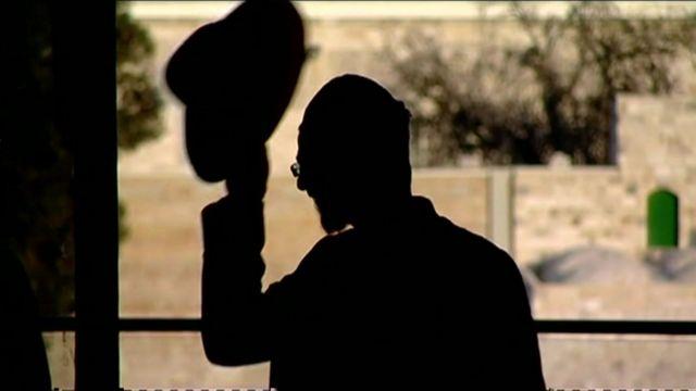 Haredi Jew removes hat