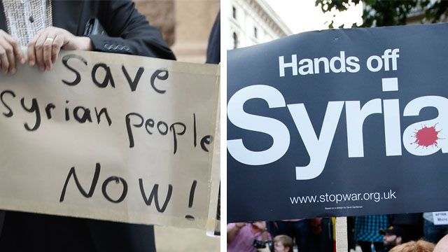 Two posters at Syria protests