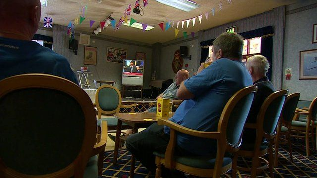 A British Legion Club in Portsmouth. Men sitting on chairs watching the TV