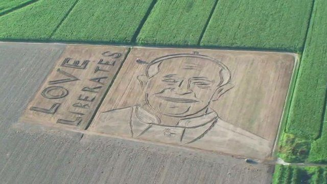 The portrait of Pope Francis ploughed into a field