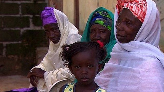 Gambian female circumcisers and child