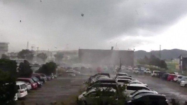 A tornado sweeps across a car park in Japan
