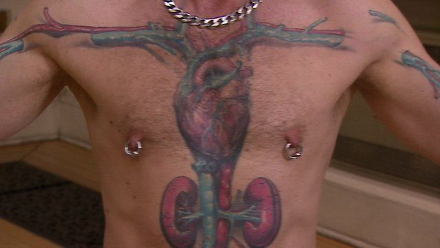 Man with organs tattoed on chest