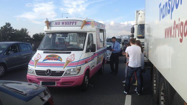 Commuters getting refreshments from an ice cream van