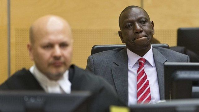 "Kenya""s Deputy President William Ruto (R) reacts as he sits in the courtroom before his trial at the International Criminal Court (ICC) in The Hague September 10, 2013."