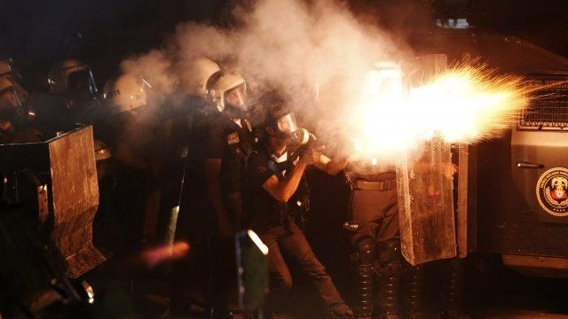 Riot police fire tear gas at protesters during clashes in central Hatay, September 11, 2013
