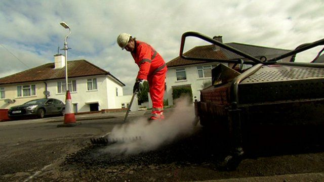 Pothole being mended