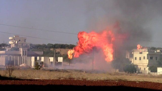 Burning building in Syria
