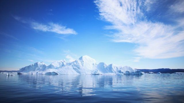 An iceberg floats through the water on July 20, 2013 in Ilulissat, Greenland