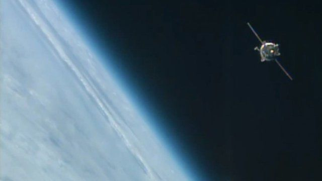 The Soyuz capsule approaching the International Space Station