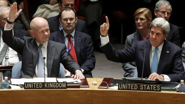 William Hague and John Kerry vote at UN Security Council