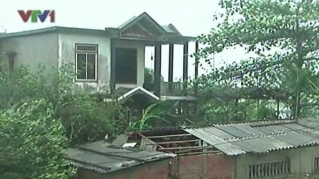 Building affected by Typhoon Wutip