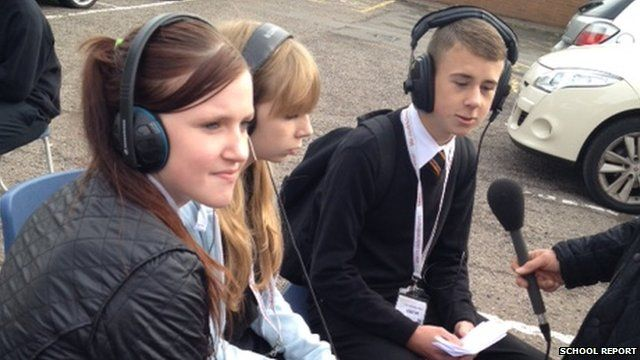 Joshua, Sophie and Courtney make use of their school car park to put their questions to climate change experts on live on BBC Radio 5 Live