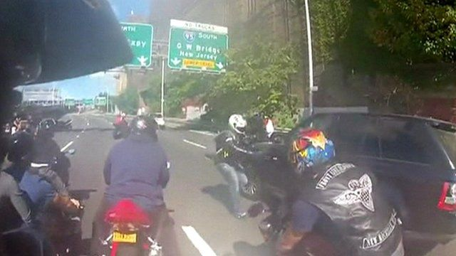 Bikes surround the car during the incident