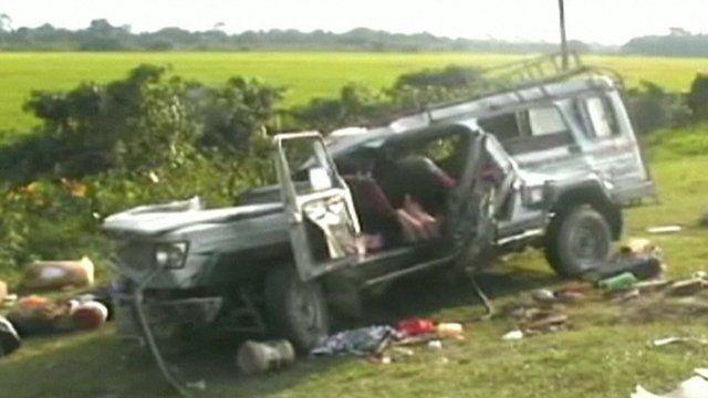 Damaged minibus after crash in Assam